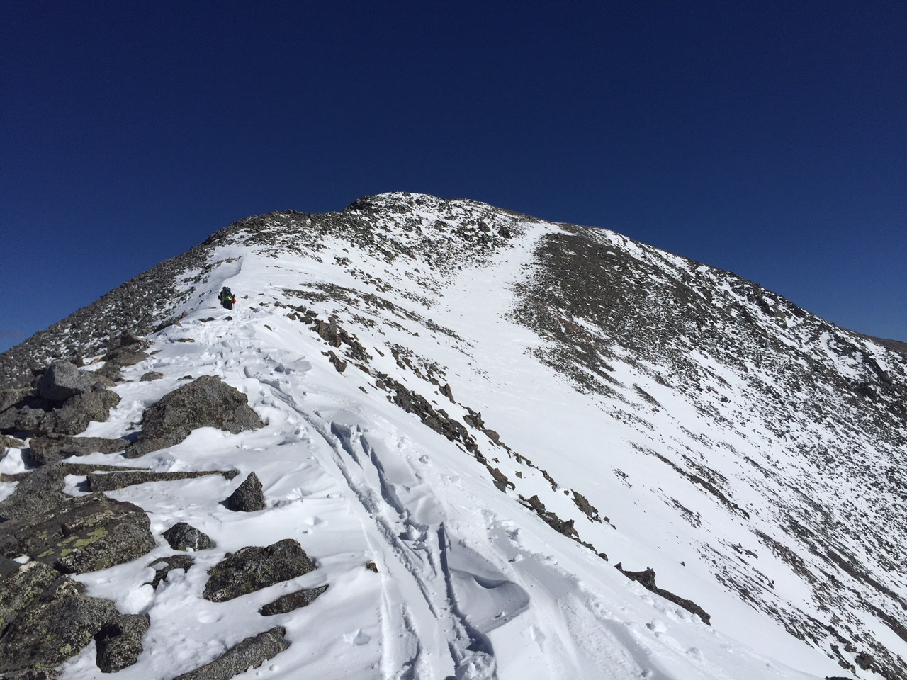 The thin ribbon on the south side of the ridge gave me just enough snow to ski!