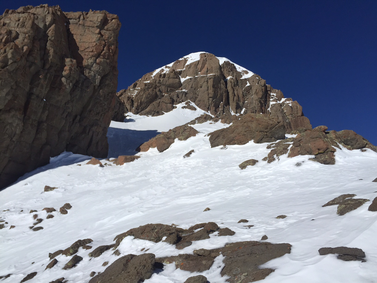 Nearing the summit pitch with the Ship's Prow (left).