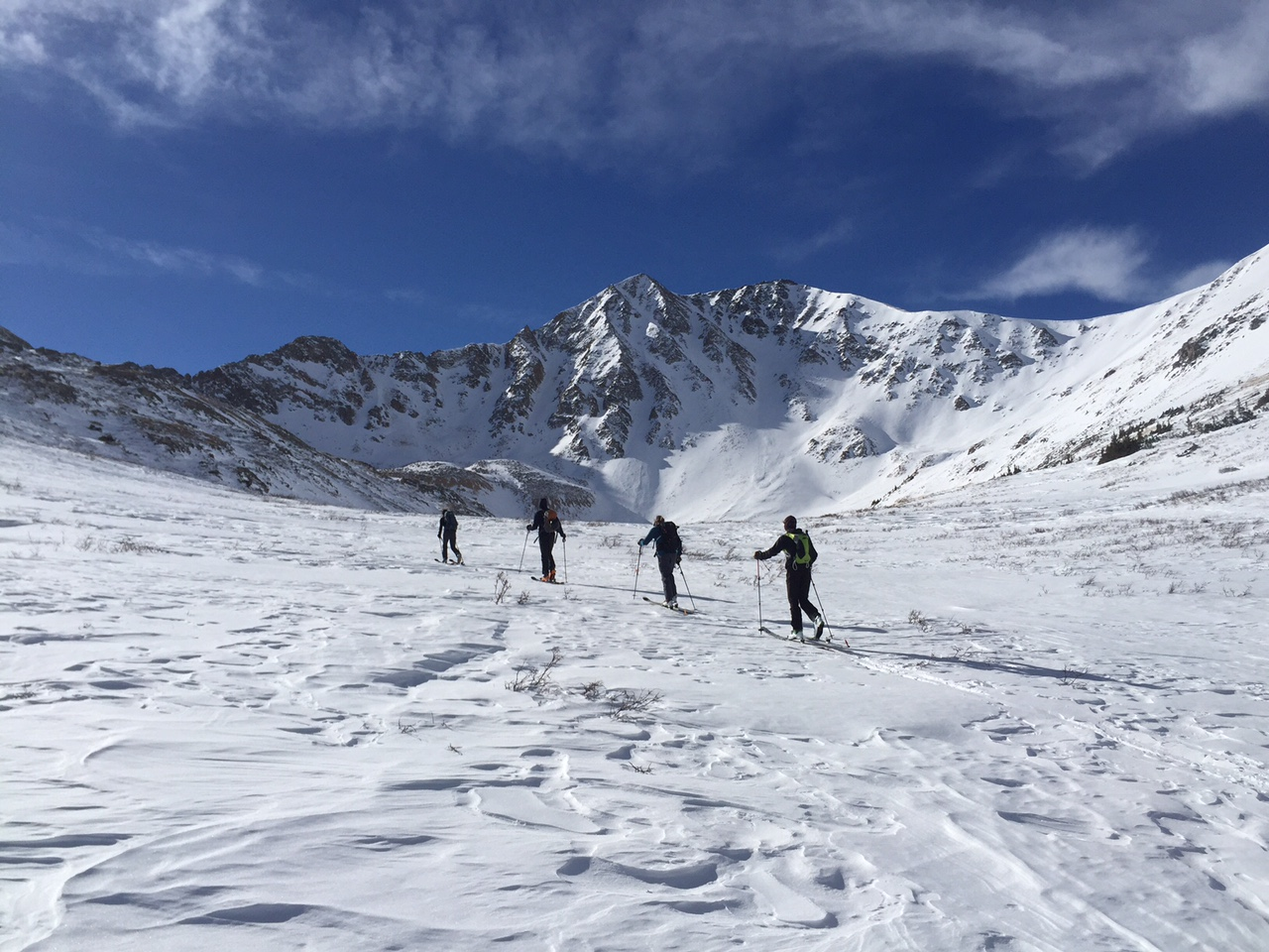 The crew moving higher in the Sayres basin en route to the southwest ridge.