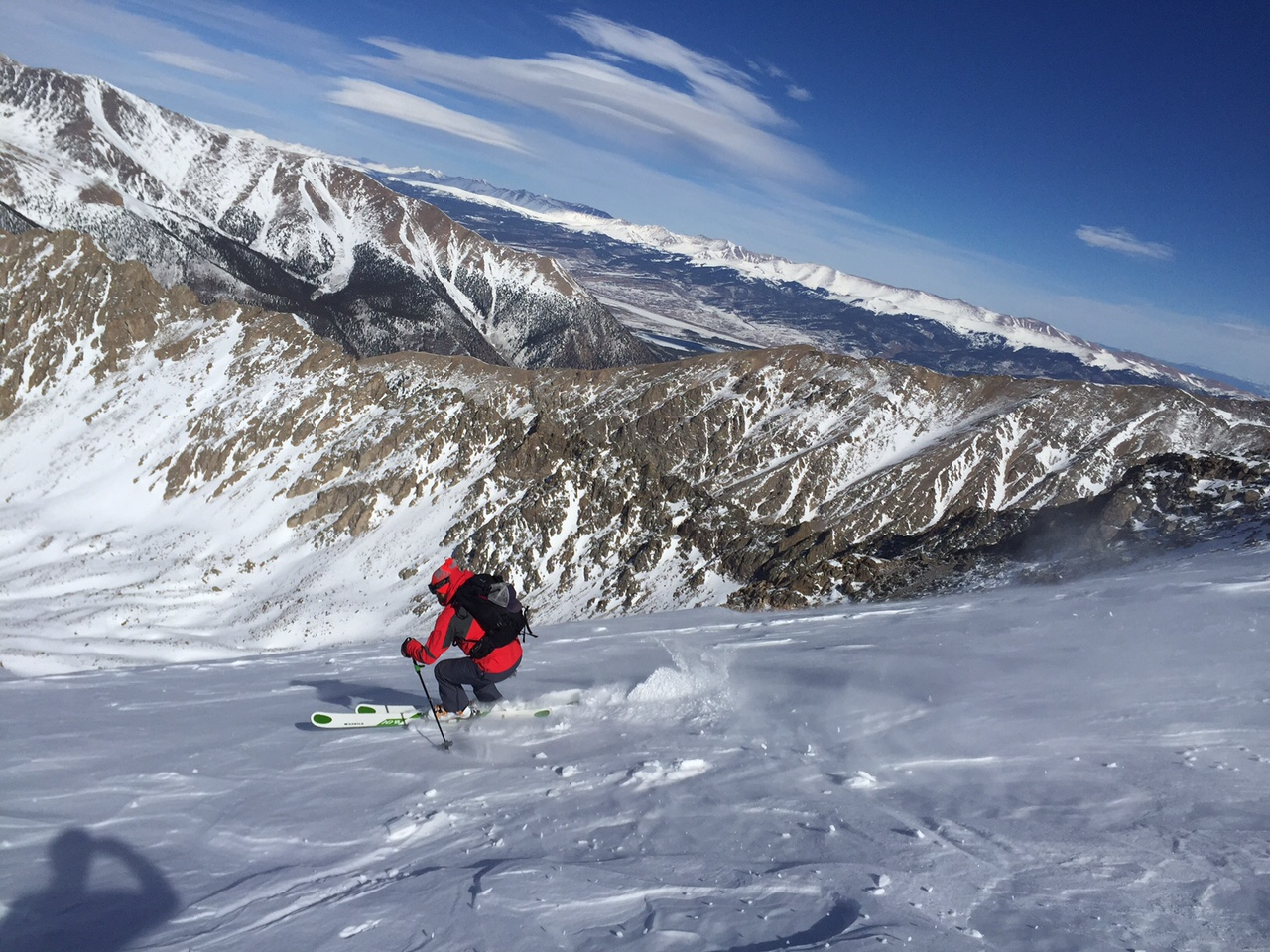 Scott carving at 14,000' with Ellingwood Ridge in the backdrop.