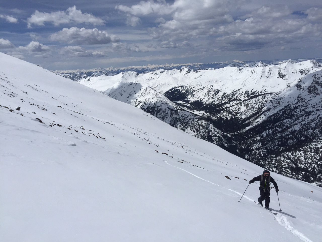 Roger putting in work as we headed to the top. Elk Range in the distance.
