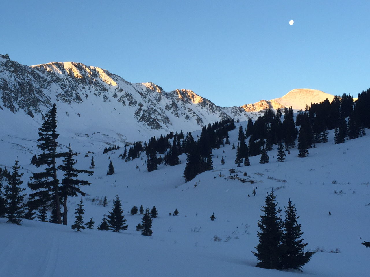 Sun coming up on Edwards Centennial (left) and Grays (far right).