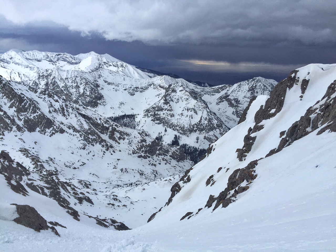 "Storm rolling in from the south as I skied down the south ""Red"" Couloir on Crestone Peak - a delightful line."