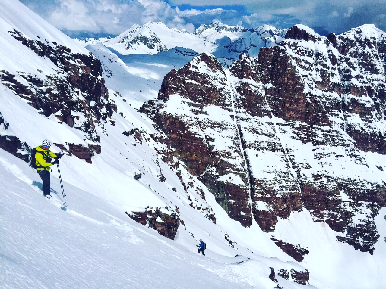 Halfway down the face, traversing the ledges in good powder in most places.